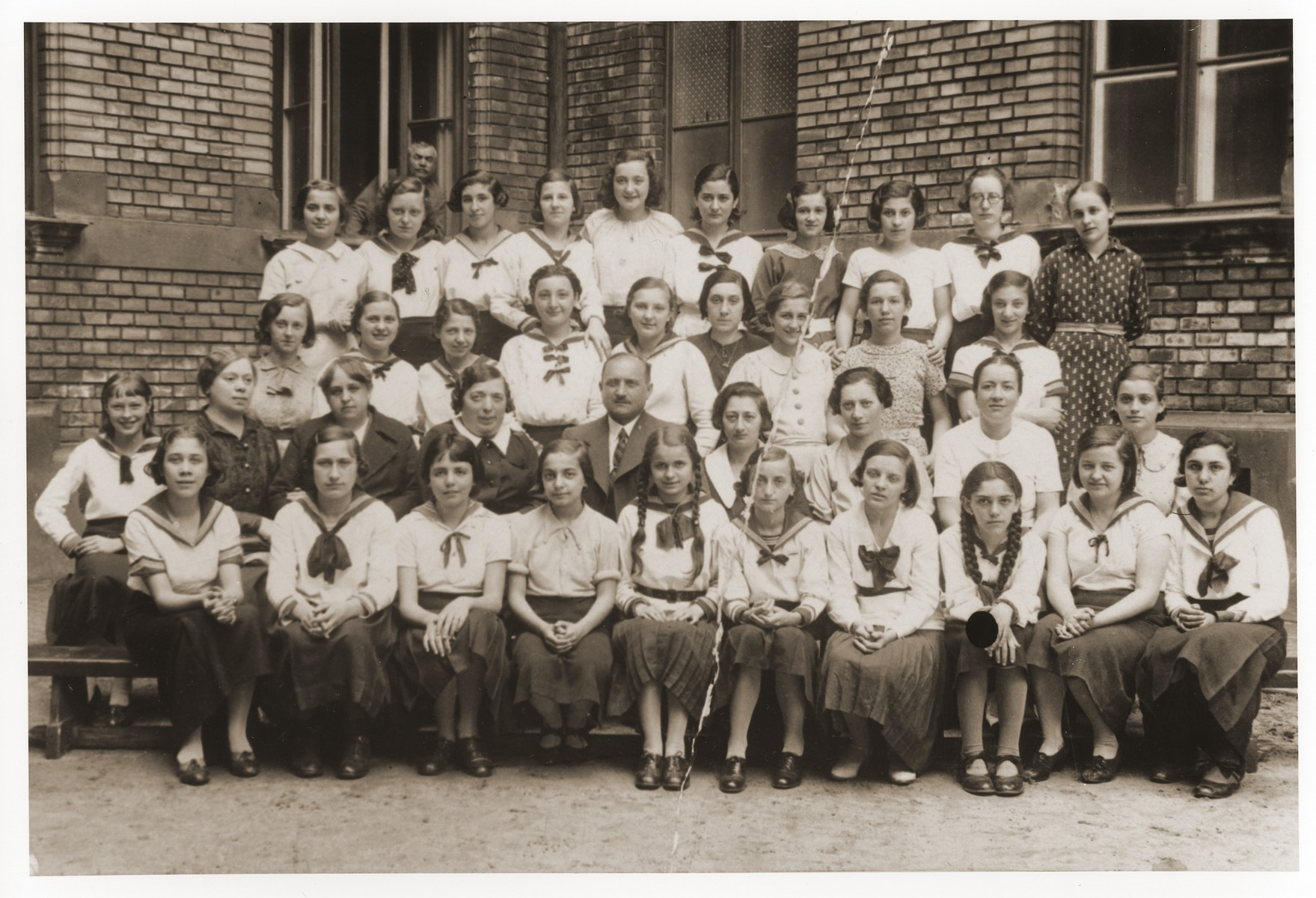 School portrait of the fourth form class (8th grade) at the Dohany Street girls school, a public school that was attended predominantly by Jews.  Pictured in the front row, third from the left, is Olga Gelb, the donor's mother (b.1922).