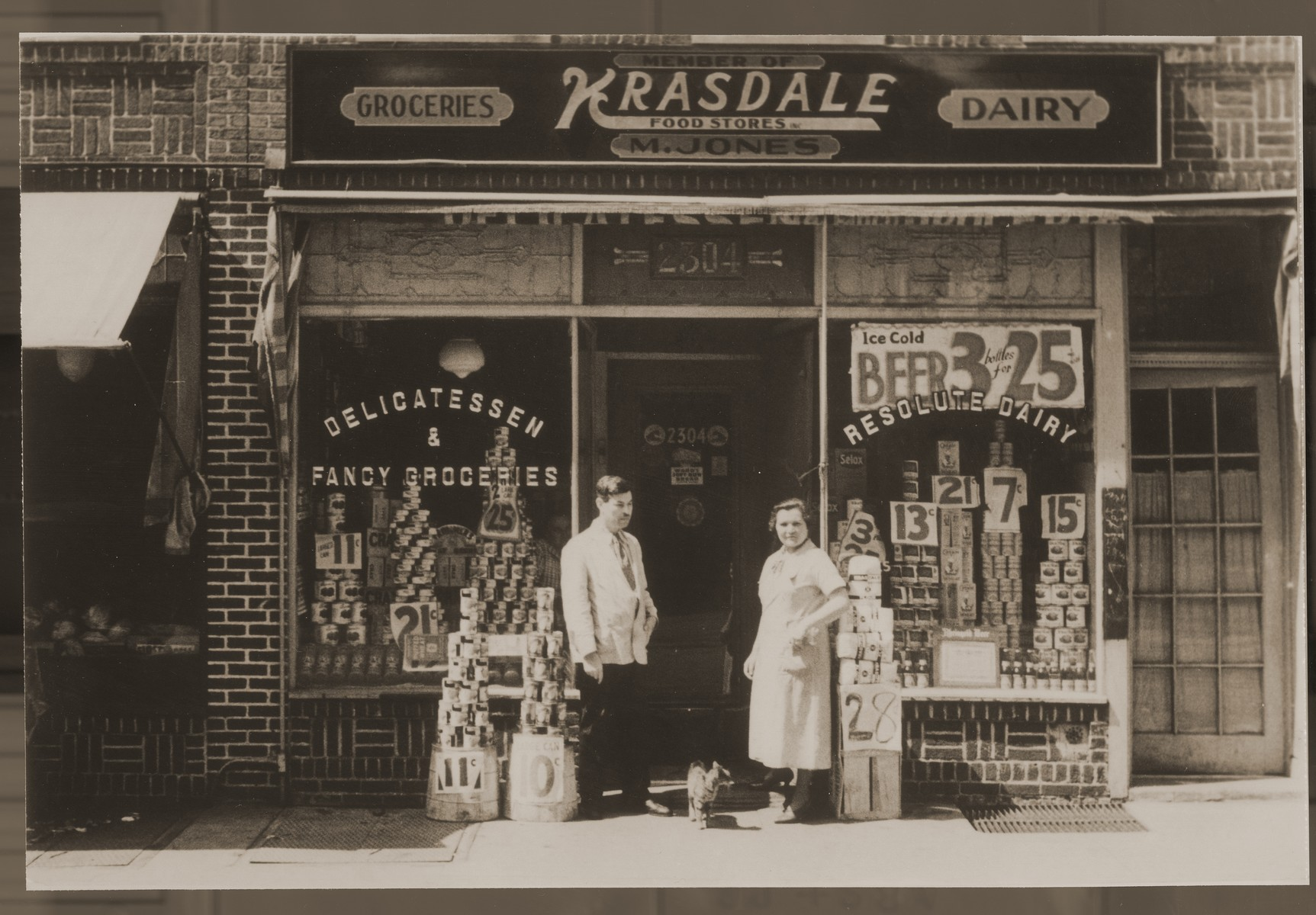 Morris and Chaya Gar Jones in front of their grocery store in New York. Chaya Gar, the donor's mother, came to America at the request of her cousin, Morris Jones, whom she married soon after her arrival in 1930.
