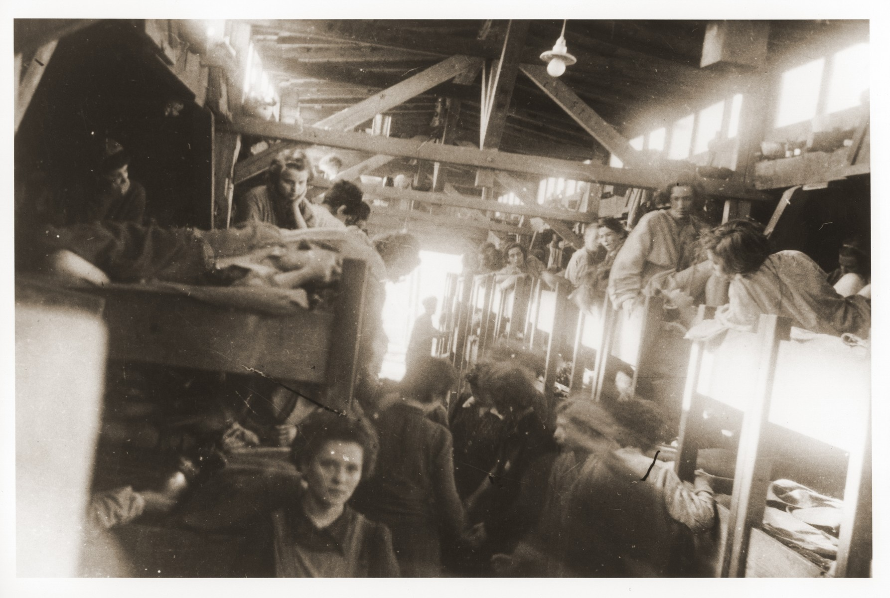 Survivors in the women's barracks at the newly liberated lower camp of Mauthausen.