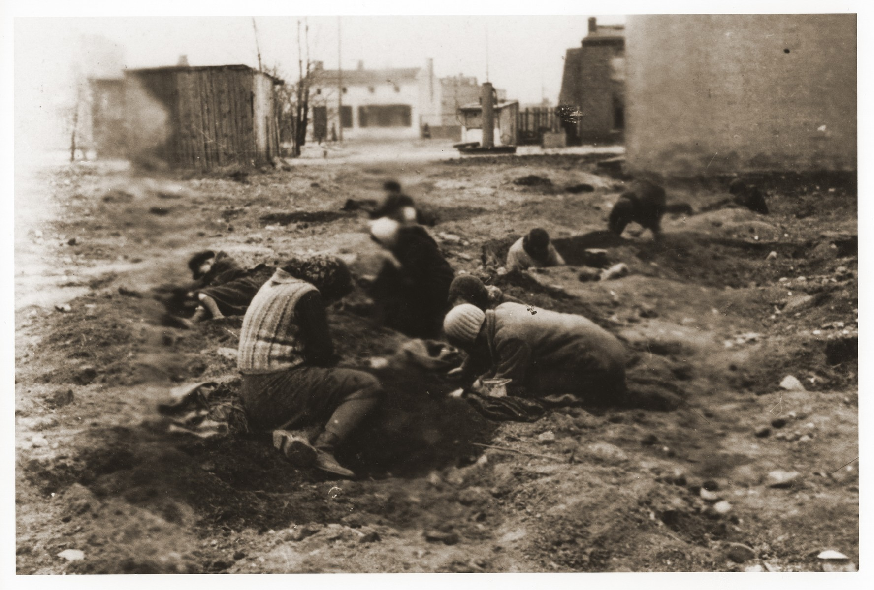 Children dig for fuel in an empty lot in the Lodz ghetto.