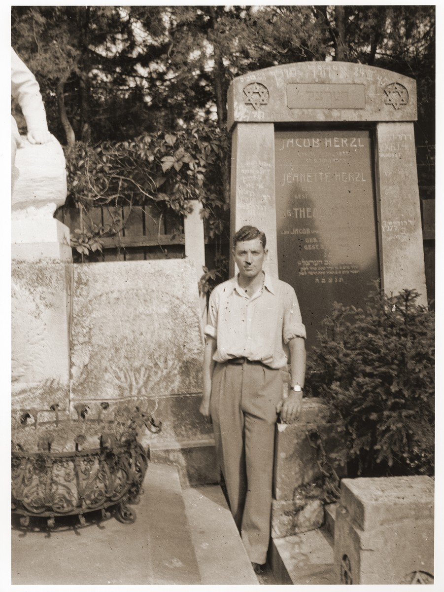 George Birman poses in front of the tomb of Theodor Herzl in Vienna.