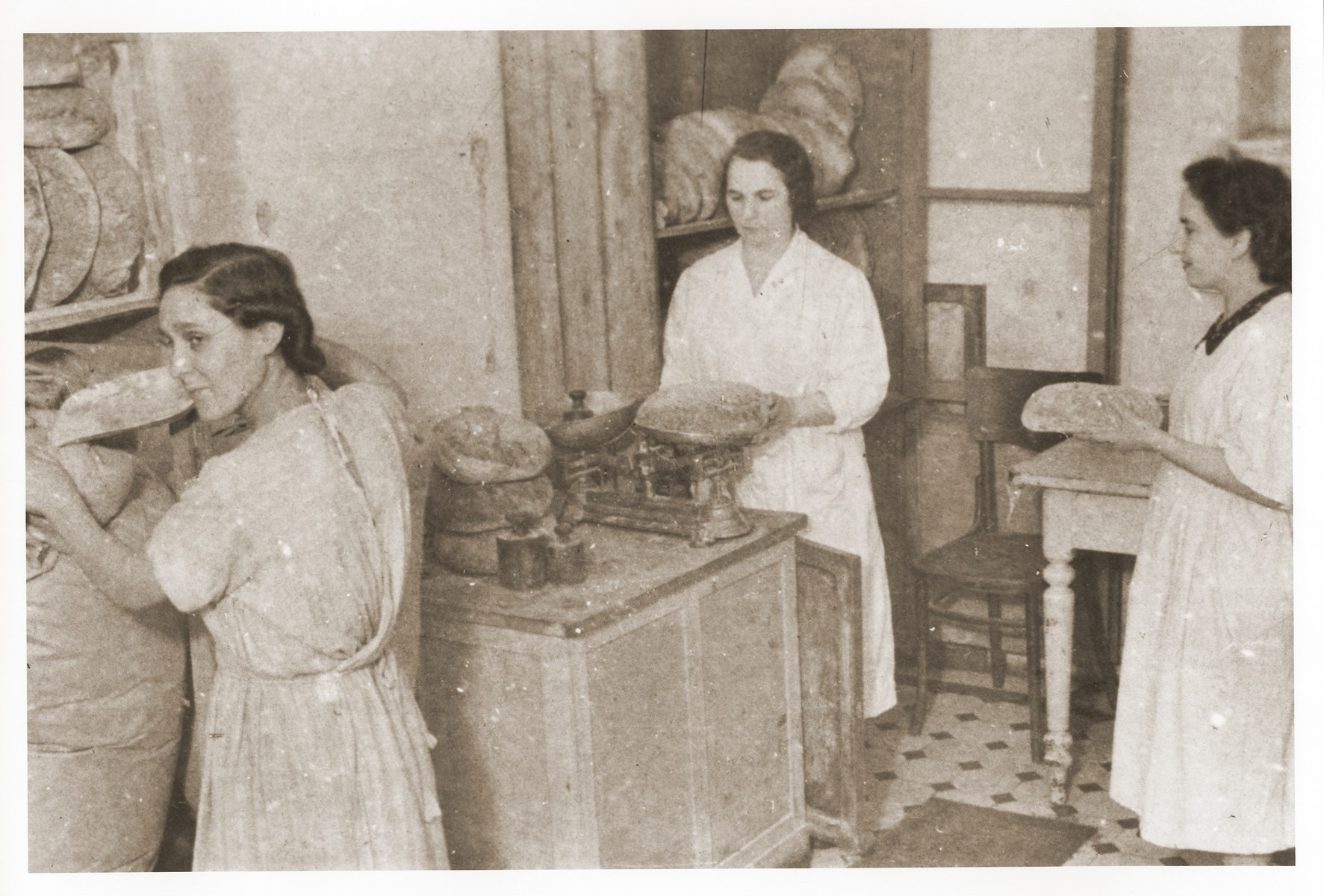 Three women working in a bakery in the Lodz ghetto.