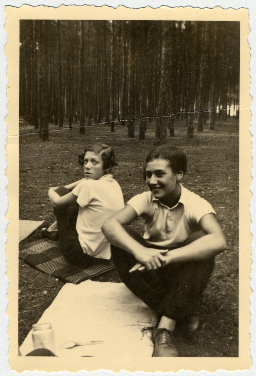 Two German Jewish teenage girls go for an excursion in the woods with their Shomer Hatzair youth movement.  Pictured in front is Marion Sauerbrunn.