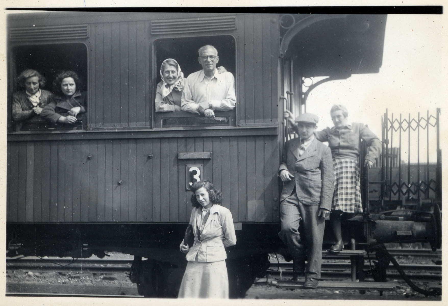 A German Jewish couple looks out the window of a train [perhaps in advance of their departure to the United States on board the Marine Perch.]  Pictured are Fritz and Jachet Sauerbrunn looking out the train window on the right.