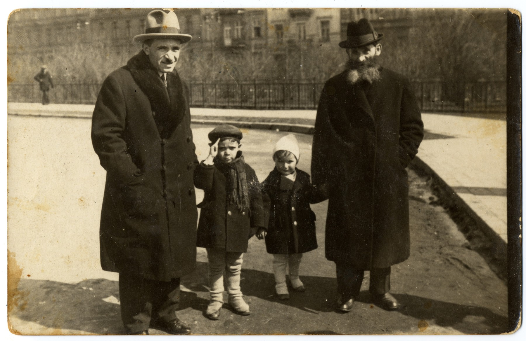 A Polish Jewish family walks on the Planty in Krakow.   Pictured from left to right are: Chaim Horowitz, Josef Horowitz, Romek Zimet (the donor's cousin) and Izaak Horowitz (the donor's grandfather).