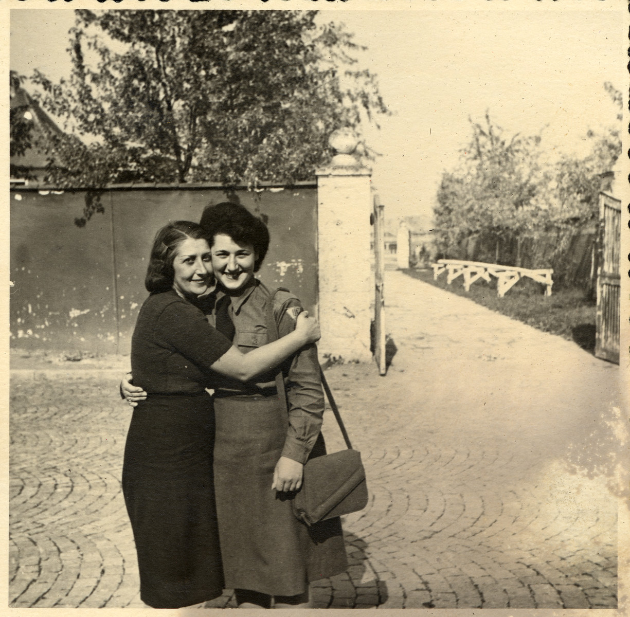After a separation of more than six years, a female resident of the Deggendorf displaced persons' camp hugs her daughter who is working nearby as a censor for the American army.  Pictured are Jachet and Marion Sauerbrunn.