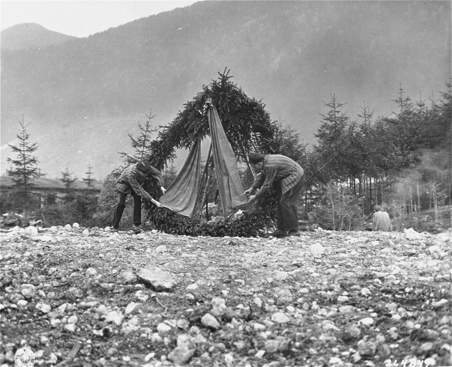 Survivors place a wreath at the site of a mass grave in the Ebensee concentration camp.