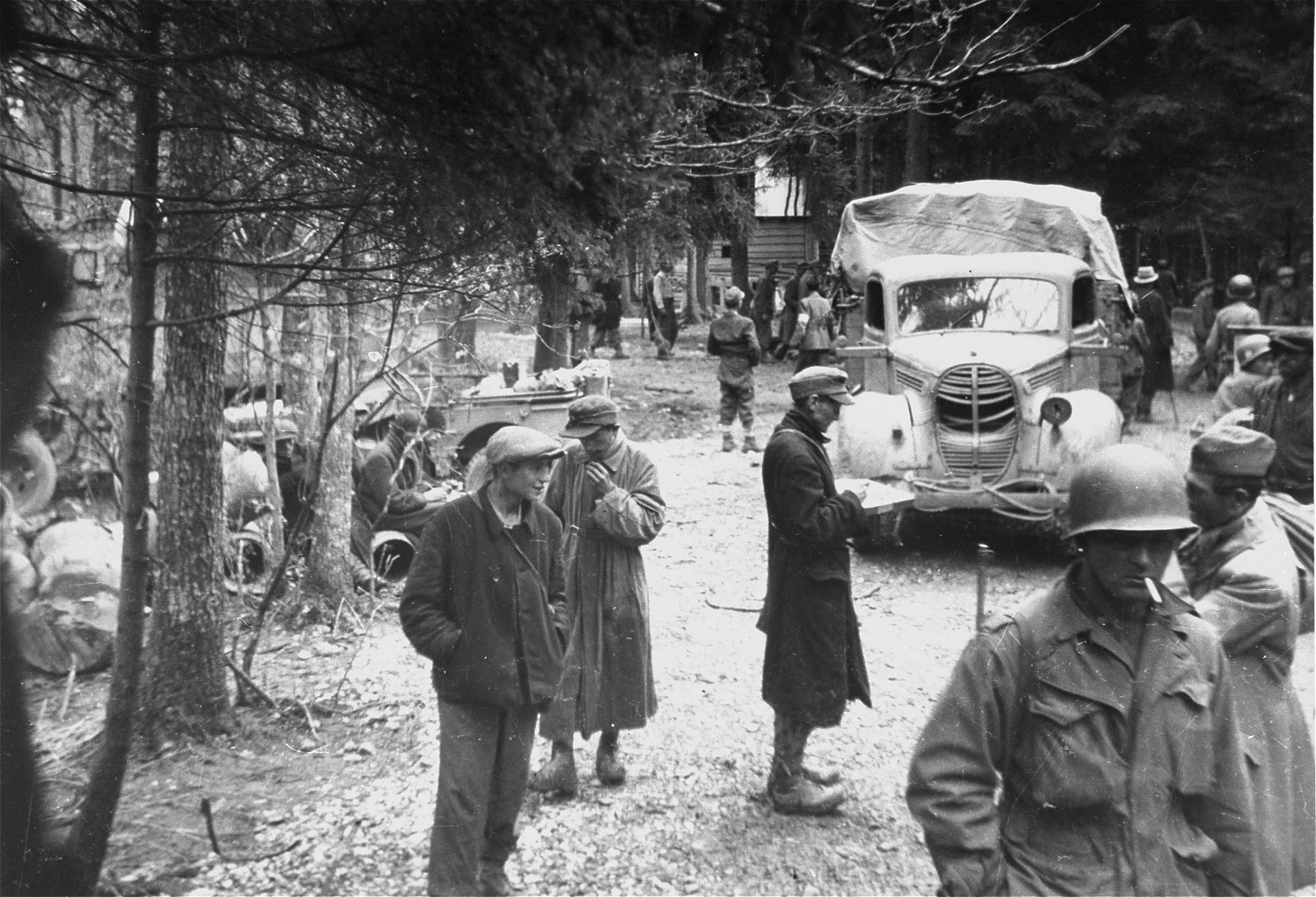 Survivors and American troops in Gunskirchen after liberation.