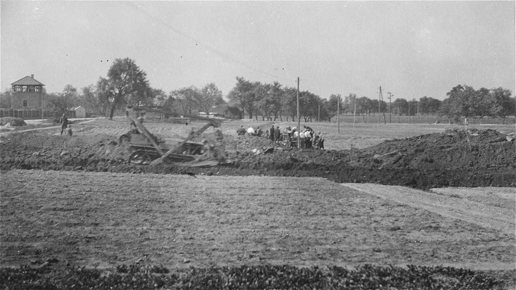 View of Austrian civilians preparing mass graves to bury former inmates in the Gusen concentration camp.