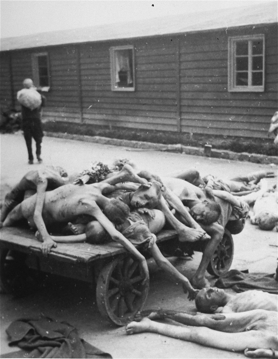 Prisoners' corpses are stacked on a cart in Gusen after liberation.