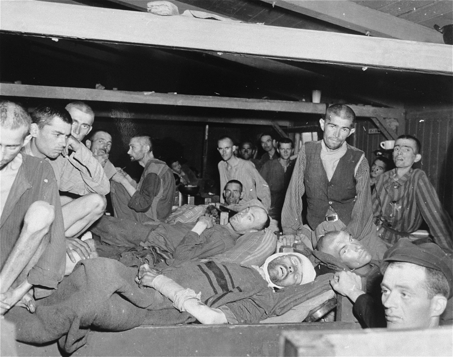 "Survivors in the ""infirmary"" of the Linz concentration camp on the day of their liberation."
