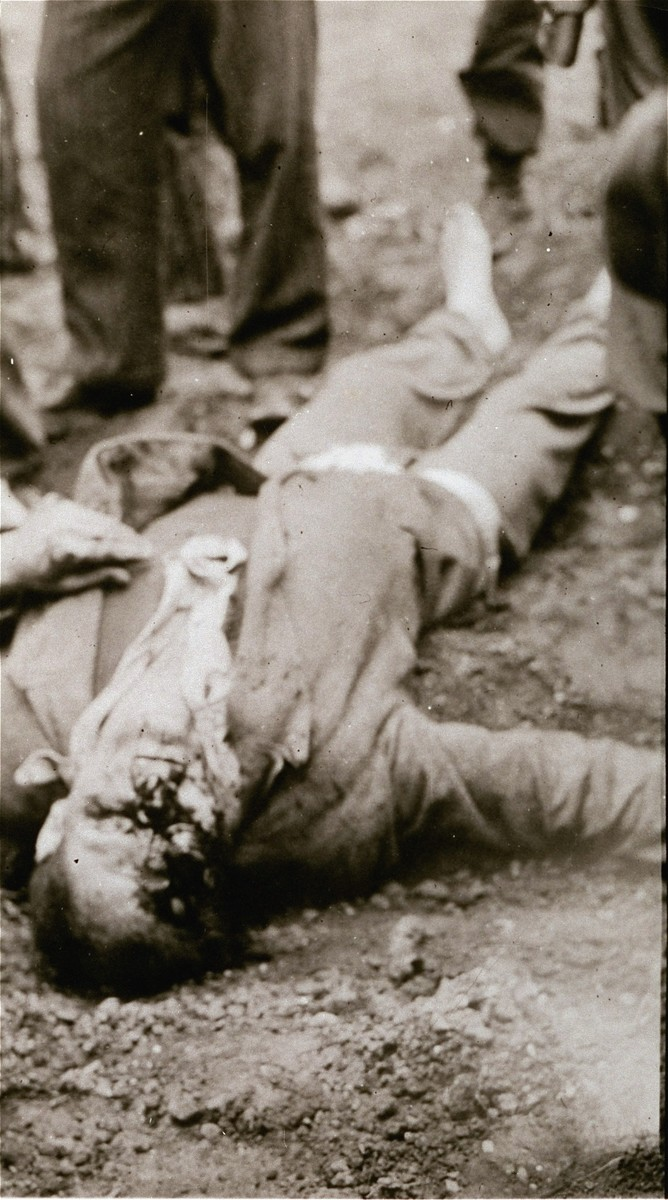 A guard shot by prisoners after their liberation.  Someone has taken his pants and shoes.
