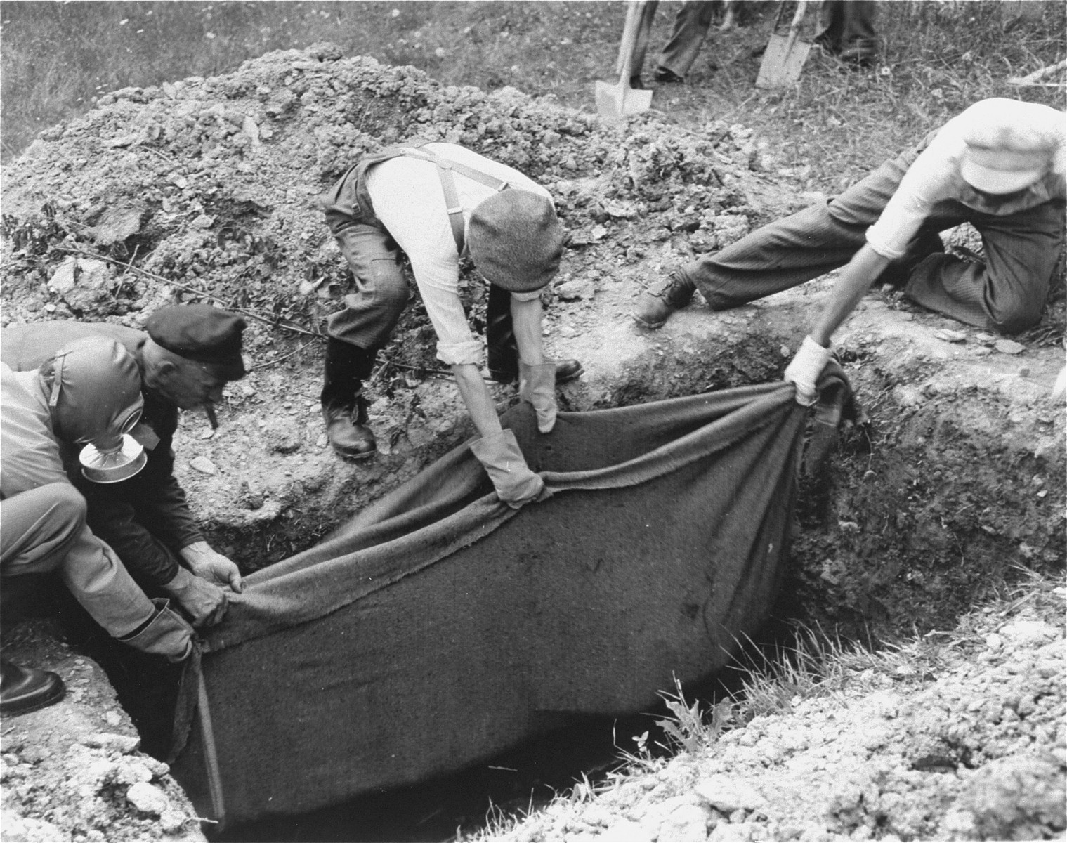 The exhumation of a grave near the Natzweiler-Struthof concentration camp.