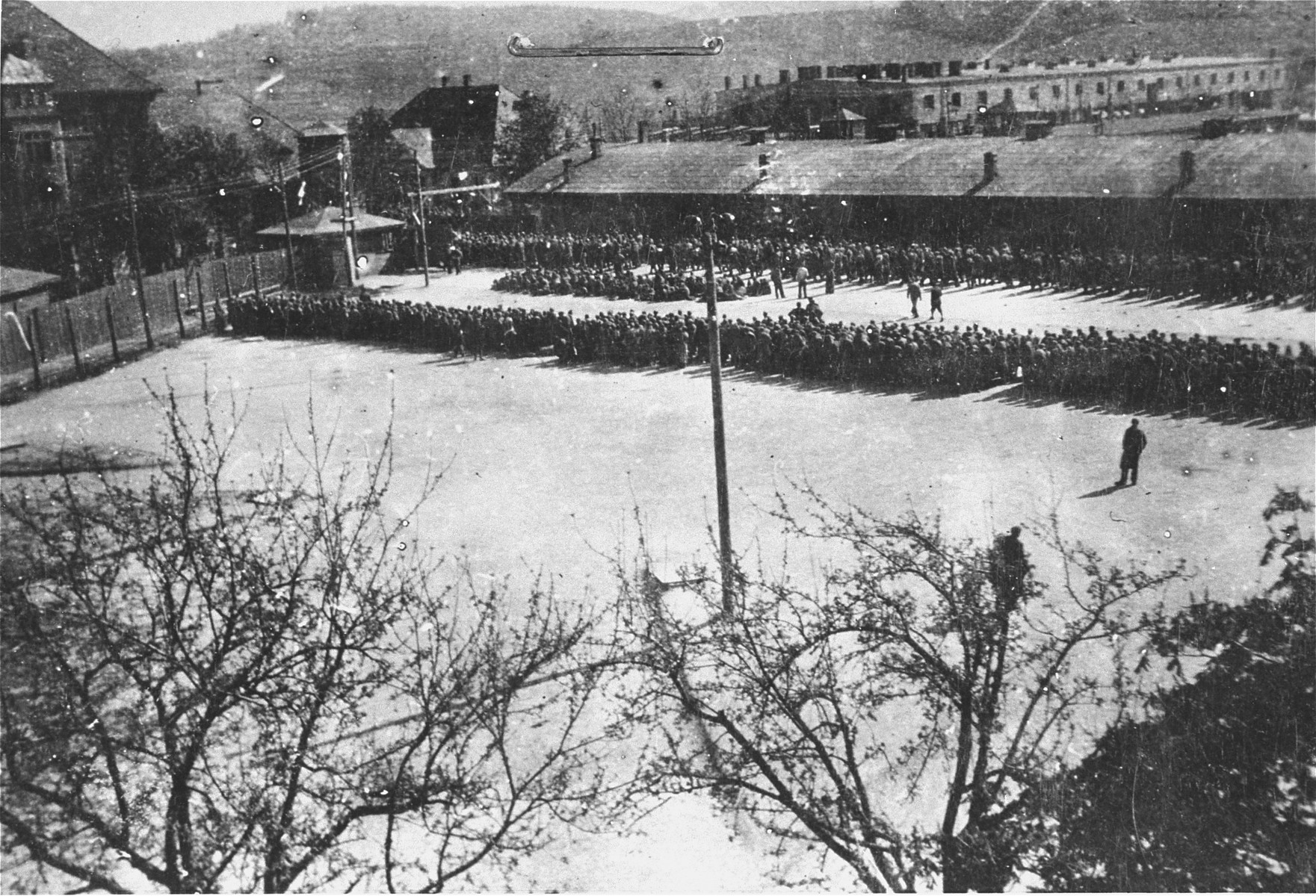Newly arrived prisoners are assembled in the Appellplatz (roll call area) at the Melk concentration camp.