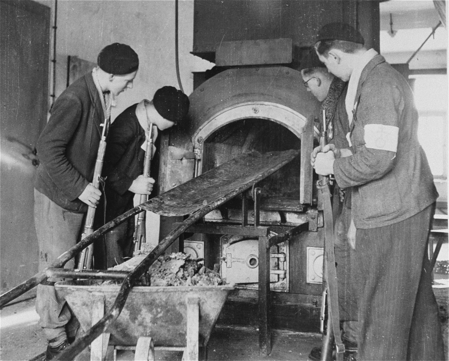Members of the French resistance inspect the crematorium furnace in Natzweiler-Struthof.