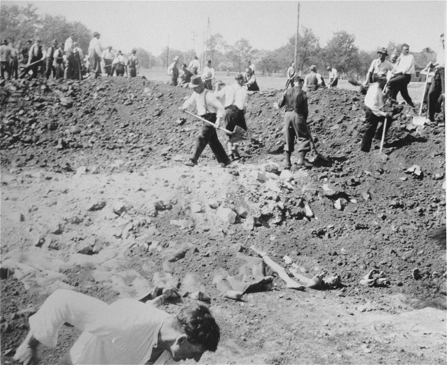 Austrian civilians prepare a mass grave to bury the bodies of former inmates in the Gusen concentration camp.