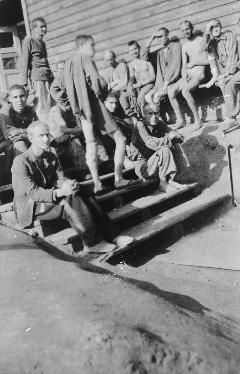 Survivors [probably of Gusen] gather outside a barracks.