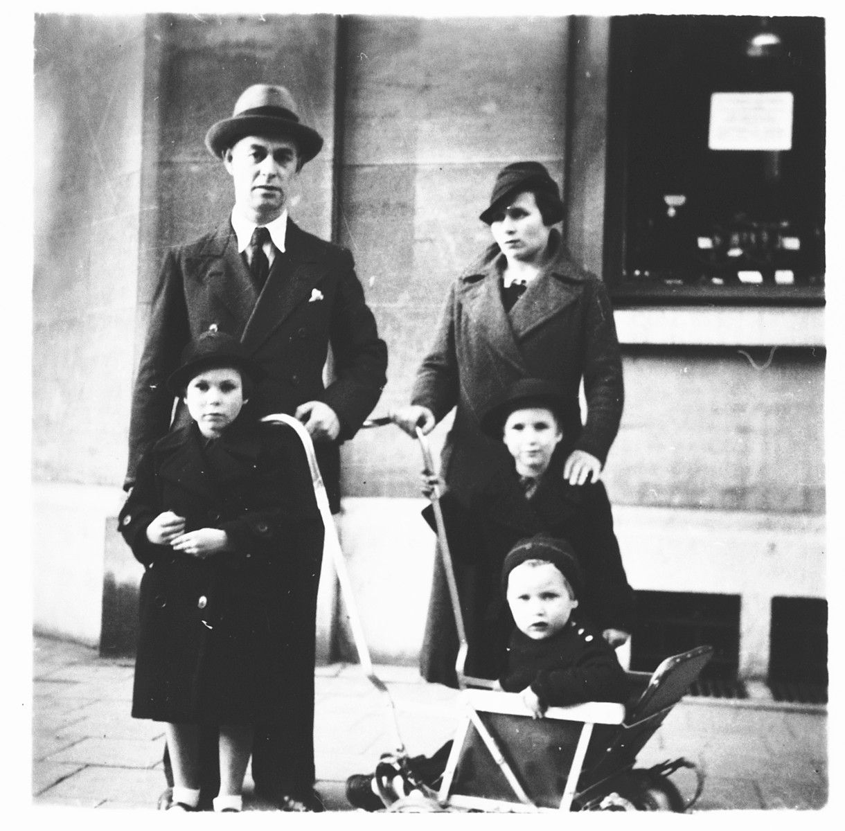 The Altenberg family poses outside a store in Antwerp.