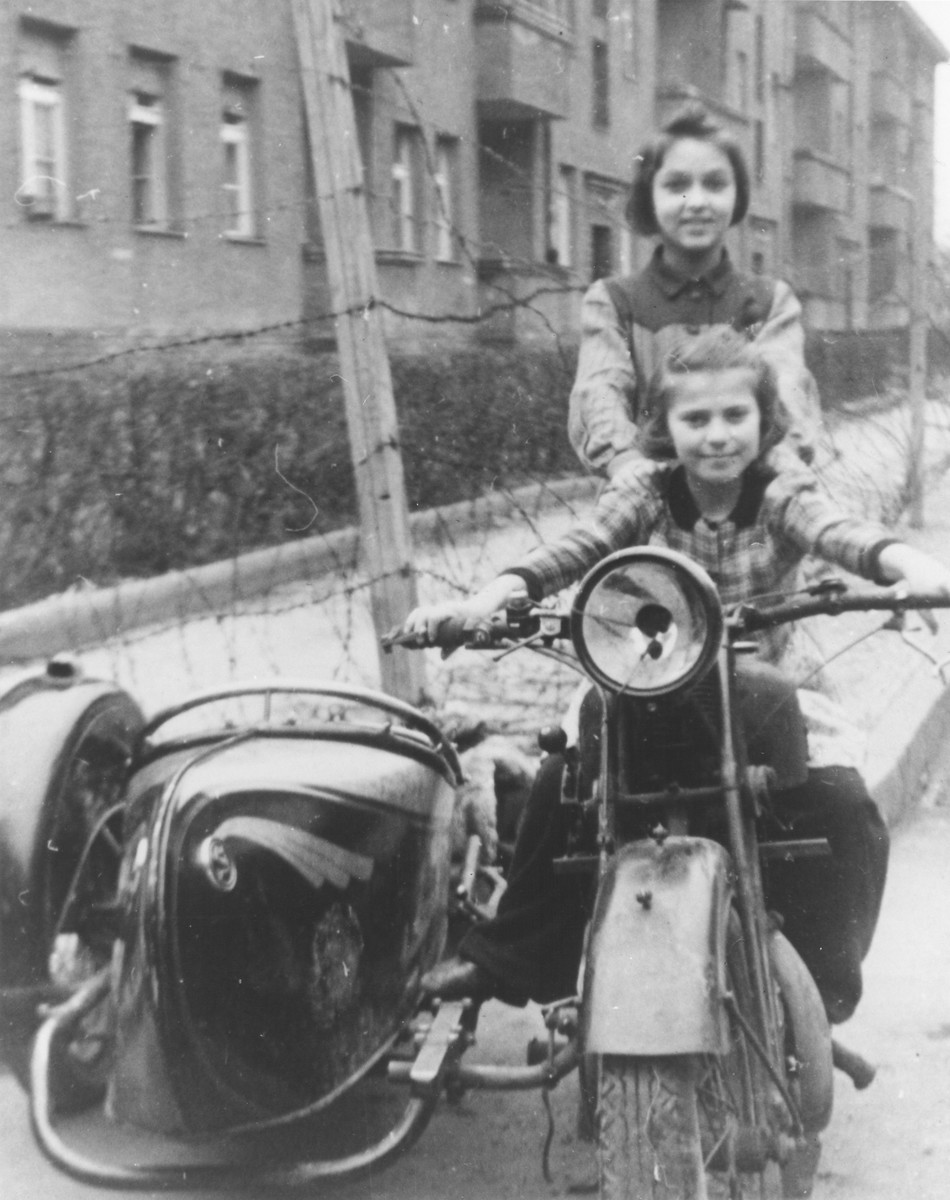 Chuma Rendler and a friend sit on a motorcycle in the Tempelhof DP camp.