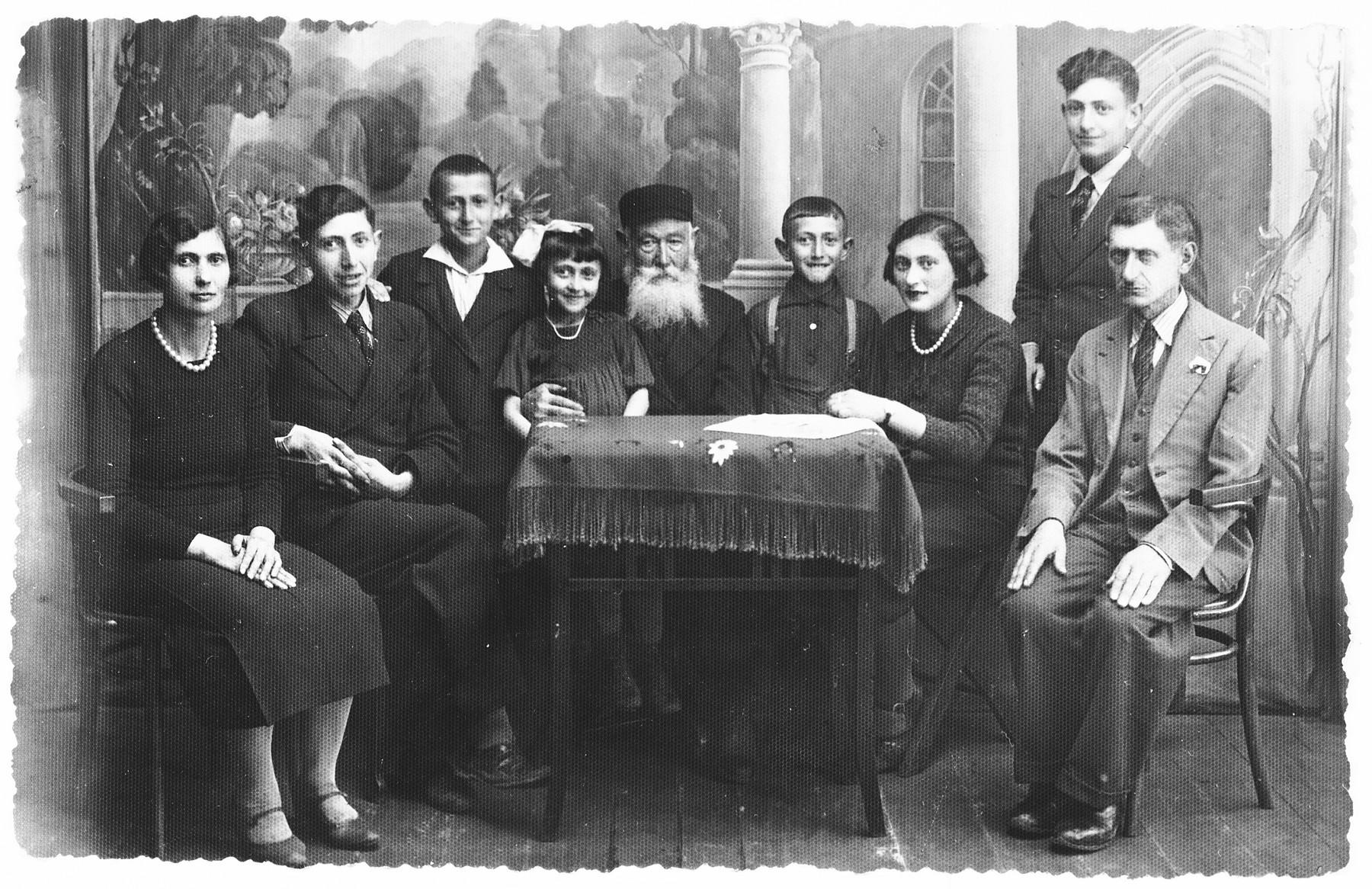 Studio portrait of a multi-generational Jewish family in prewar Zelow, Poland.