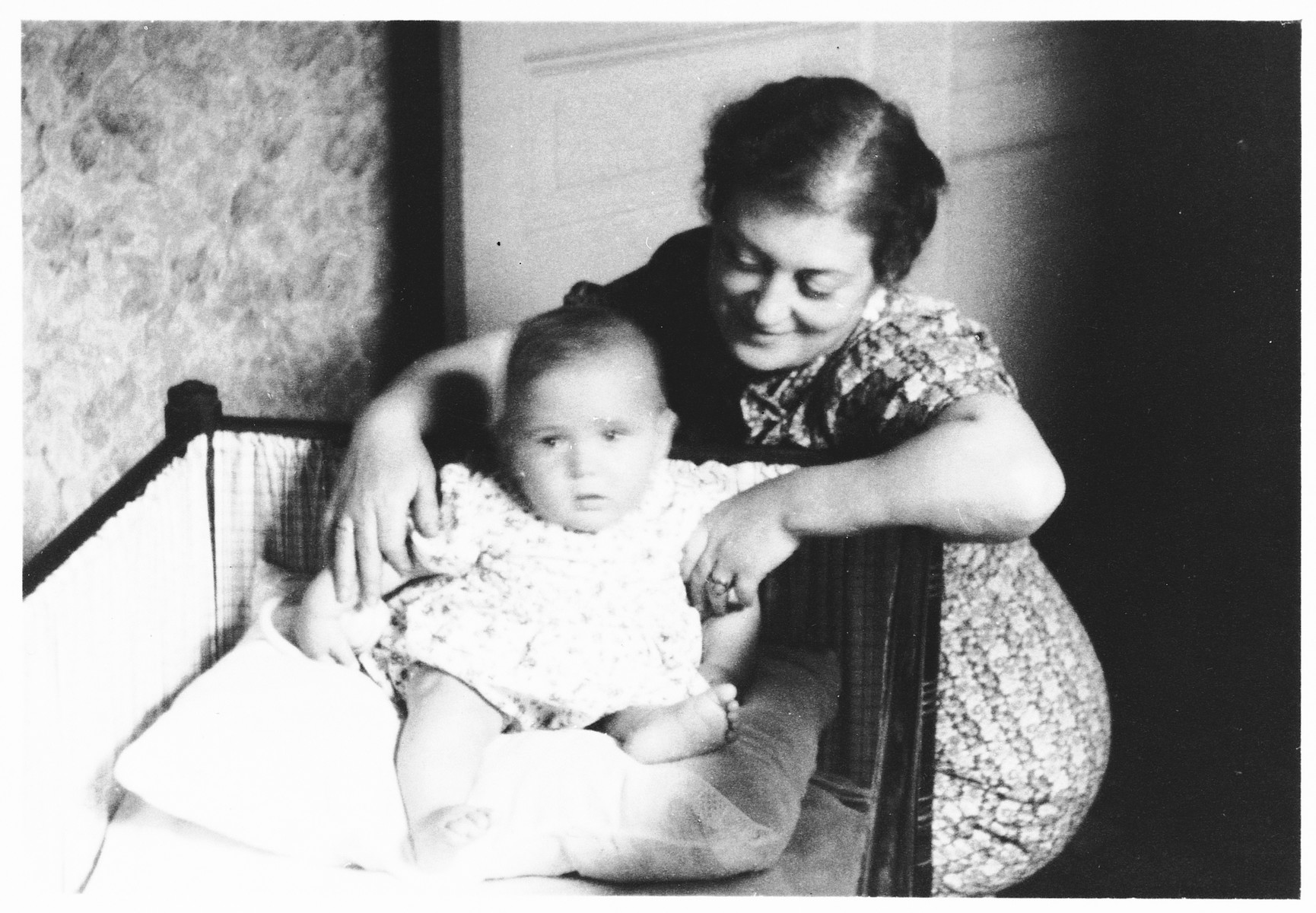 A young Jewish mother, who is living in hiding in German-occupied Belgium, visits her infant son, who is being sheltered at a convent outside Brussels.  Pictured is Lea  Abramowicz with her son, Georges.