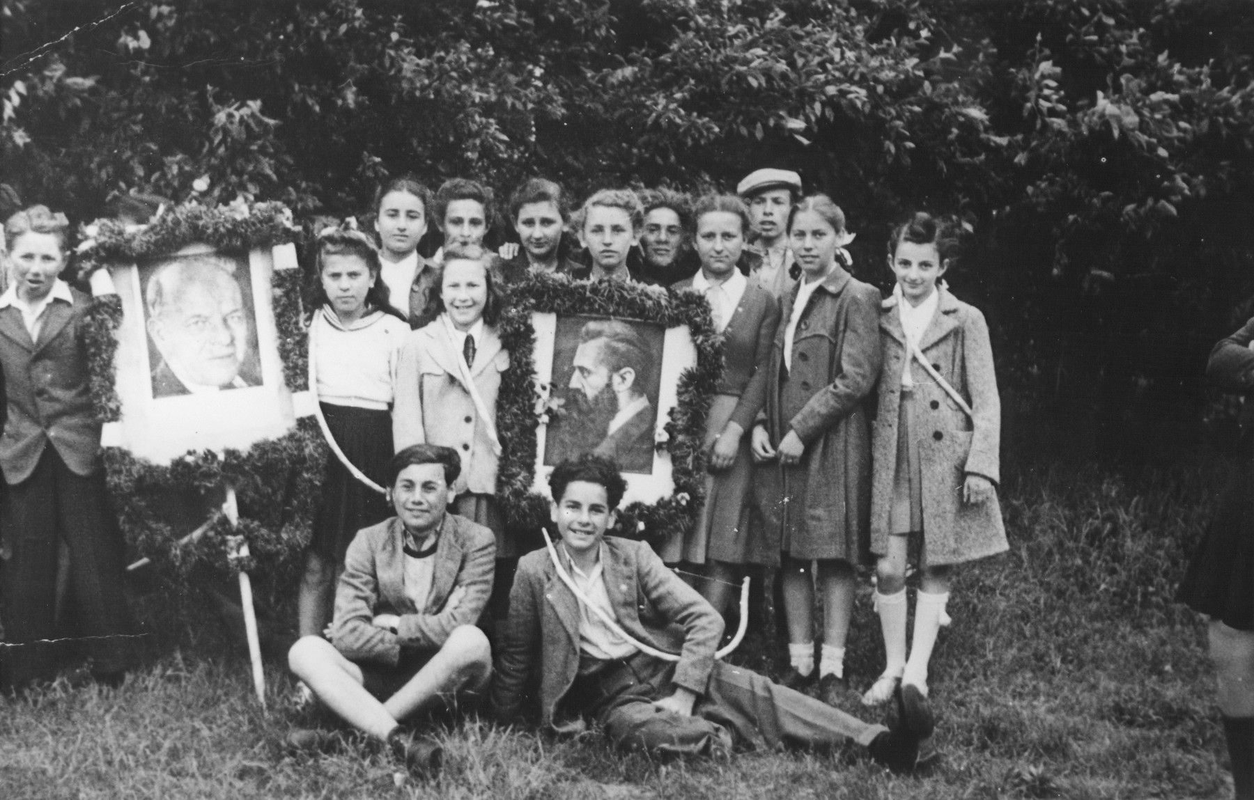 Students at the Tempelhof DP camp school go for a Lag Ba'Omer outing with bows and arrows.  Among those pictured is Chuma Rendler.