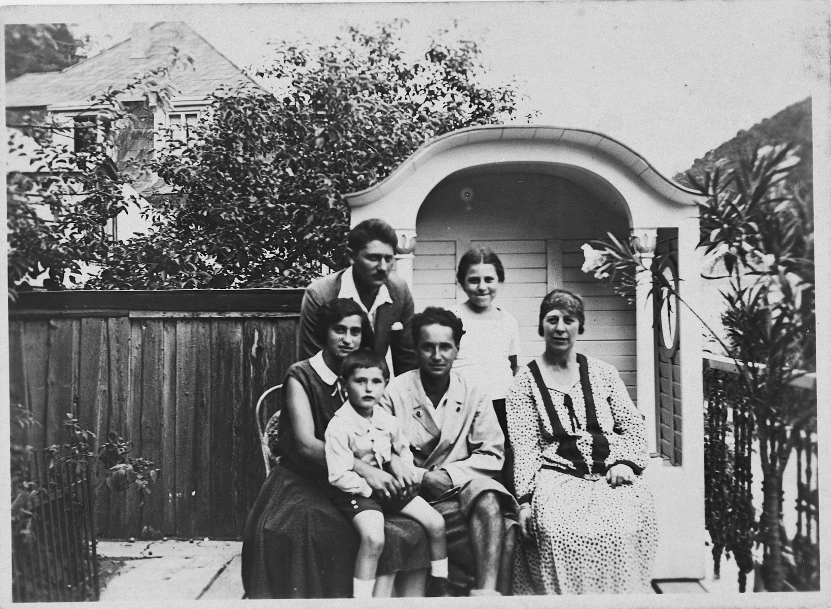 An Austrian Jewish family poses on the veranda of their home.  Pictured sitting from left to right are Henriette Altschuler, Robert Altschuler Fritz Zweigenthal and Leitschi Klaber.  Standing are Joseph Altschuler and Anny Klaber.