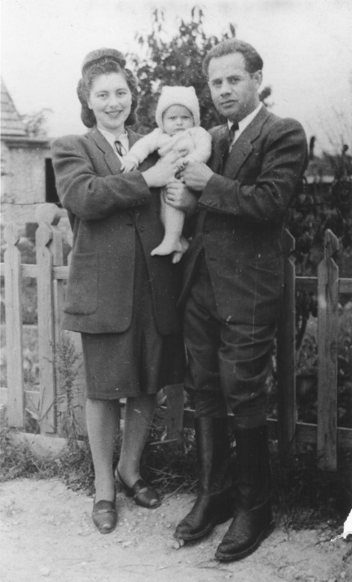 A Jewish couple poses with their young baby in Munich.