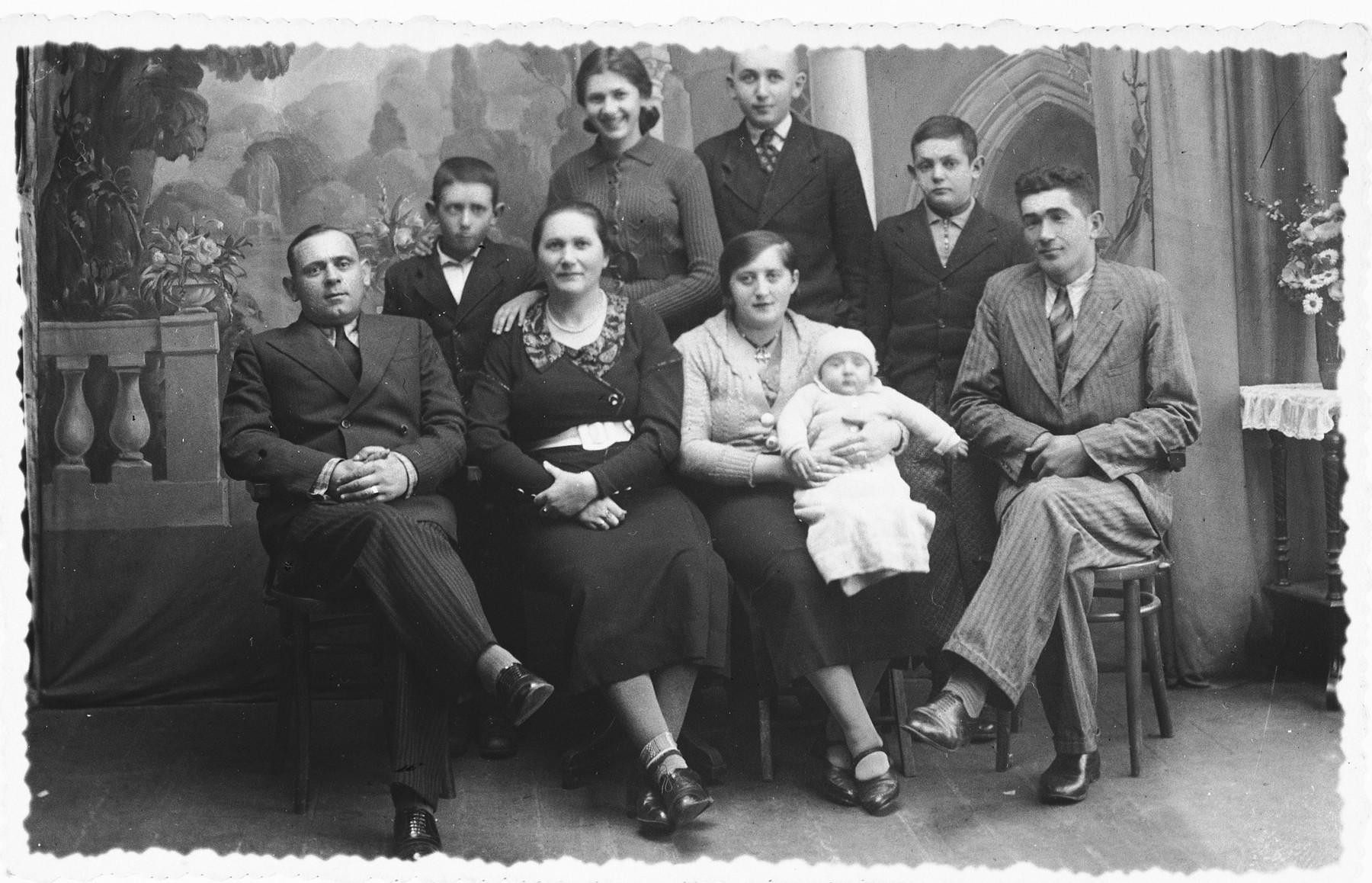 Studio portrait of the family of Henek Szmulewicz in prewar Zelow.