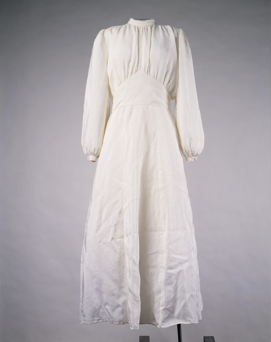 Wedding dress made from a parachute worn for a wedding in a displaced persons camp.