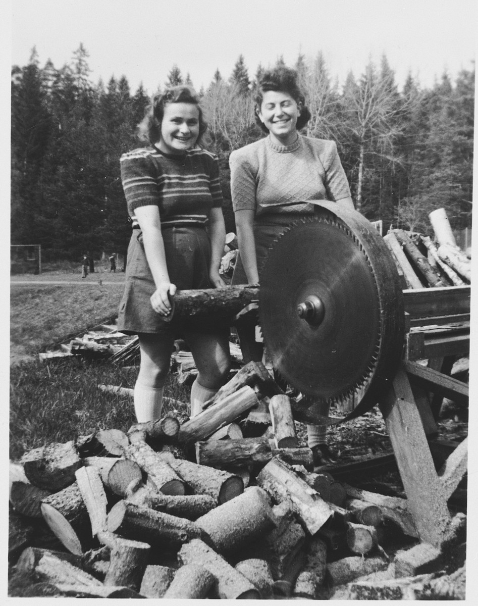Teenage girls from a religious Jewish school in Sweden work in a lumber yard.