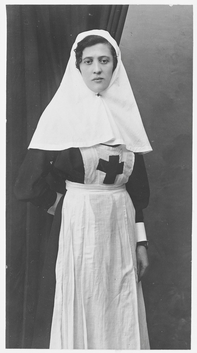 Portrait of a Jewish nurse, Anya Pevsner, in her uniform.  Anya served as a nurse during World War I.  She was later arrested by Stalin and sent to the Gulag.