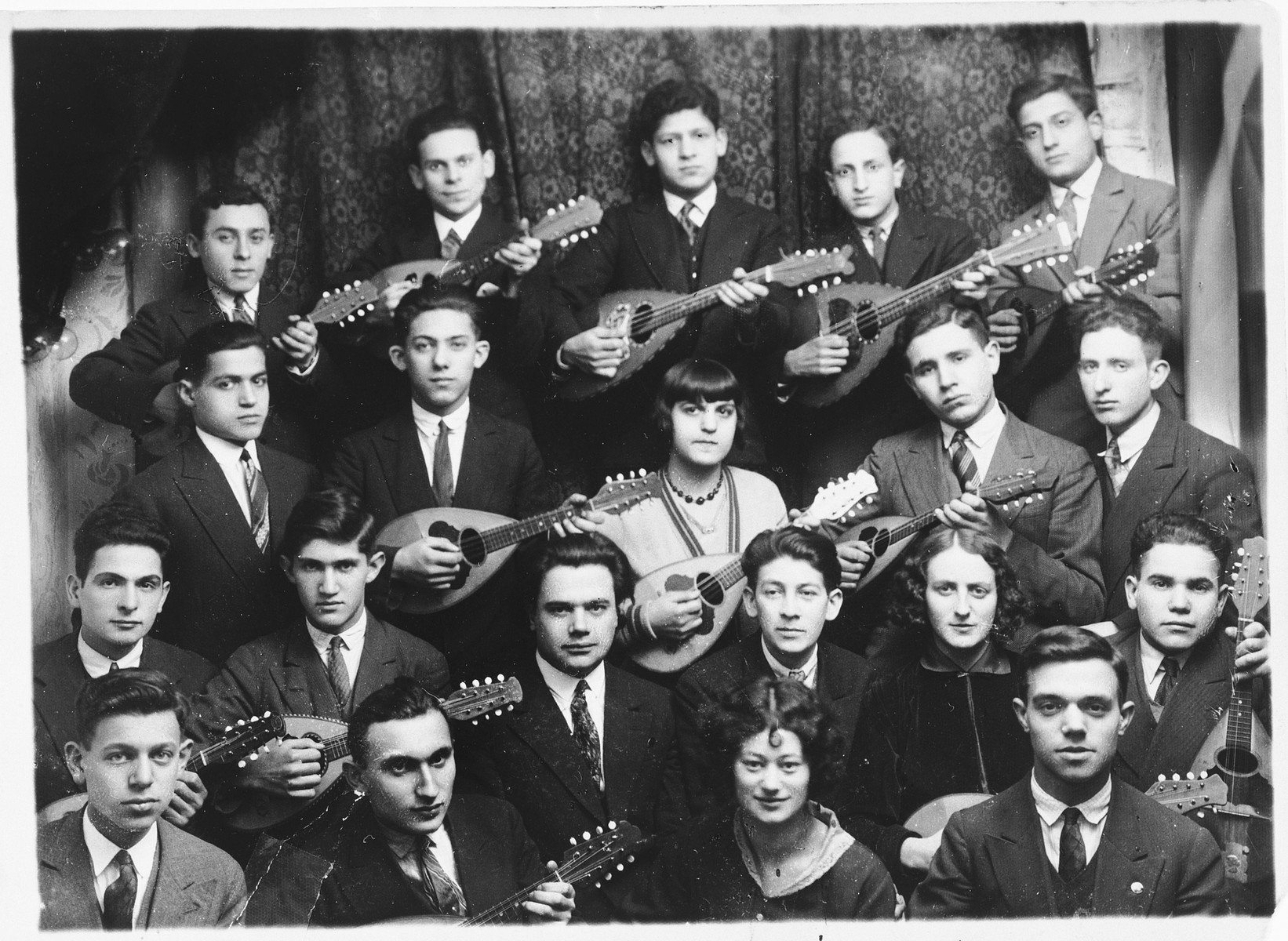 Group portrait of members of a Jewish youth movement mandolin band in Warsaw.  The young men and women belong to the Poale Zion Zionist youth movement.