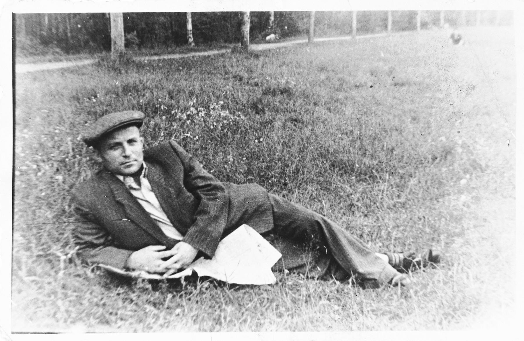 Jankiel Herszkowicz relaxes in a grassy field.