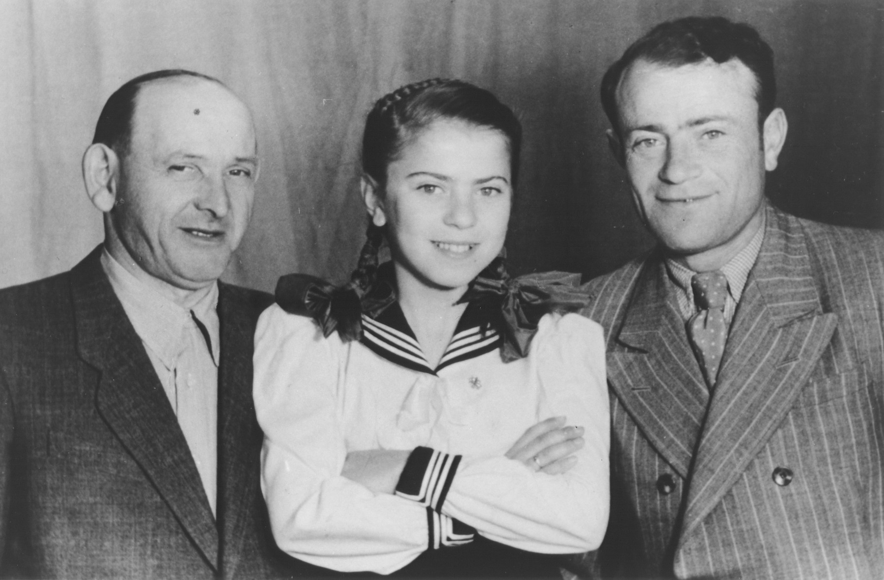 Chuma Rendler poses with her father Anchel and his cousin Israel Shusterkatz in a studio photo in the Tempelhof DP camp.