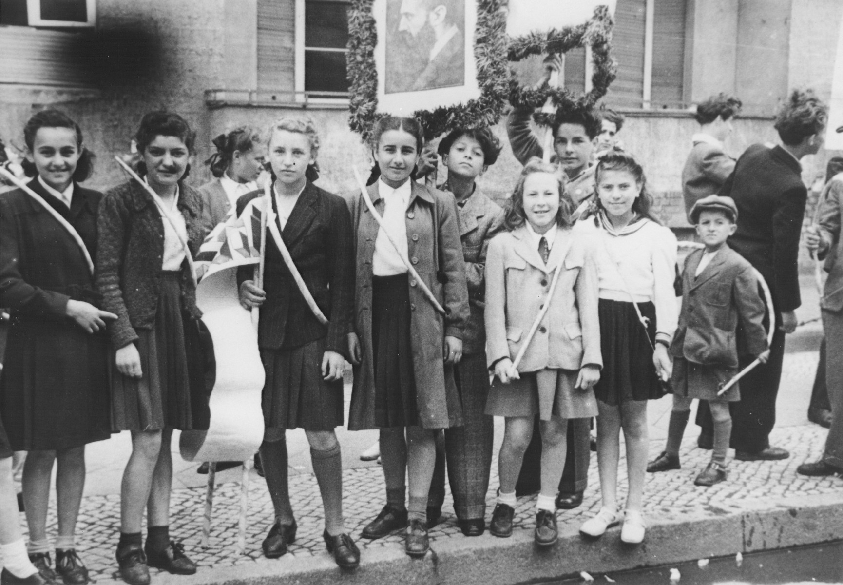 Students at Theodore Herzl school of the Tempelhof DP camp in Berlin go for a Lag Ba'Omer outing with bows and arrows.  Among those pictured is Chuma Rendler.