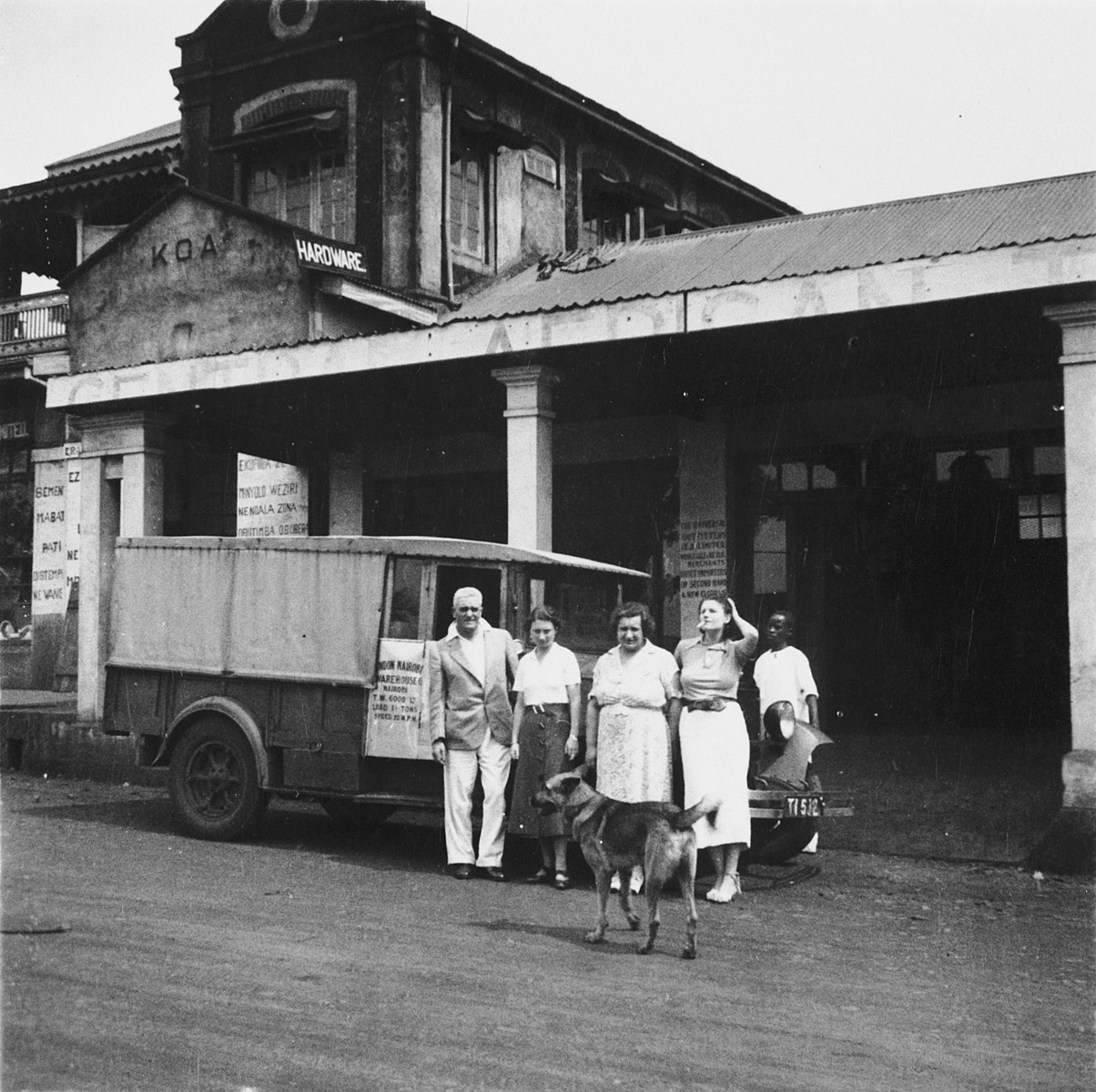 German Jewish refugee Ruth Weyl poses outside a store in Kampala, Uganda with members of an English family who befriended her.