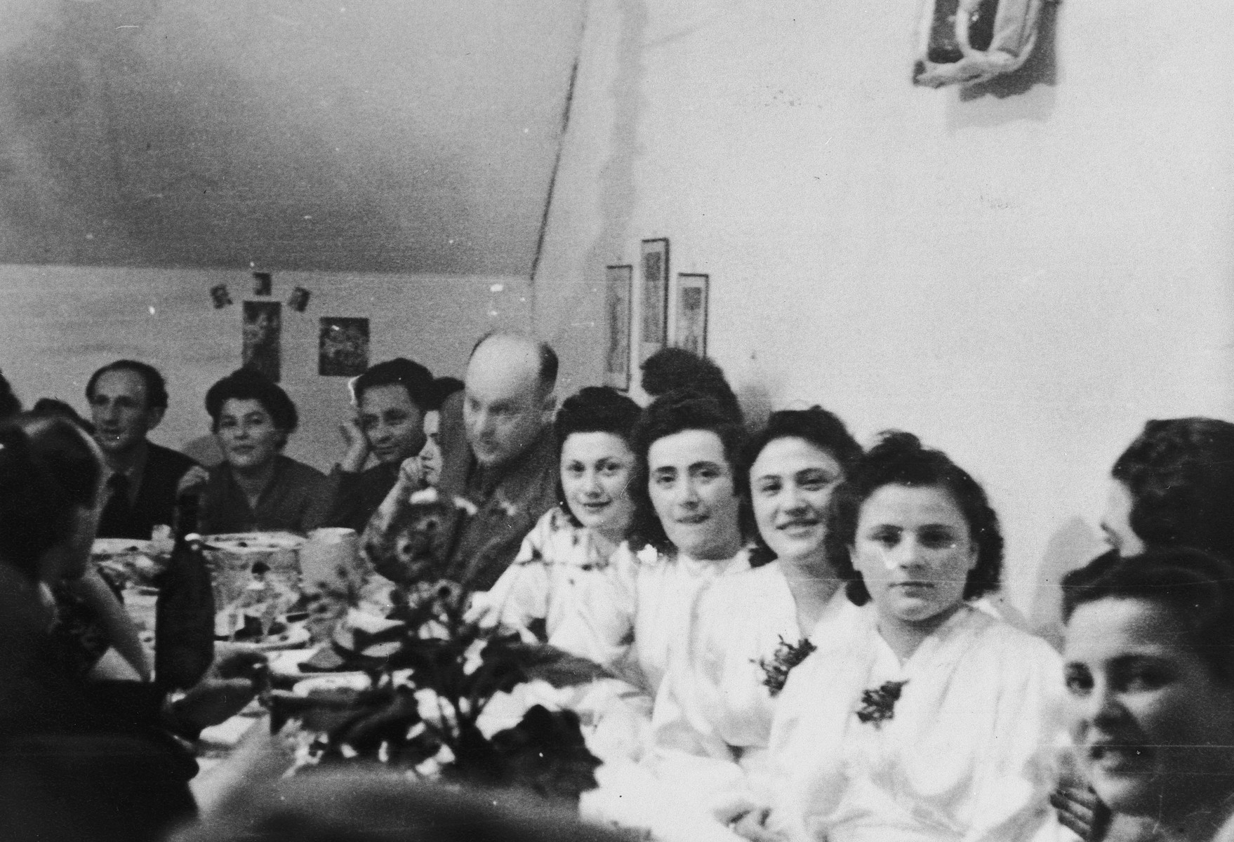 Four brides celebrate their joint wedding in the Foehrenwald displaced persons camp.  Pictured are Eva who married Martin Libitzky, Regina who married Sam Lubka, Sofia who married Felix Lubka and Mariusia who married Moniek Zweibaum.