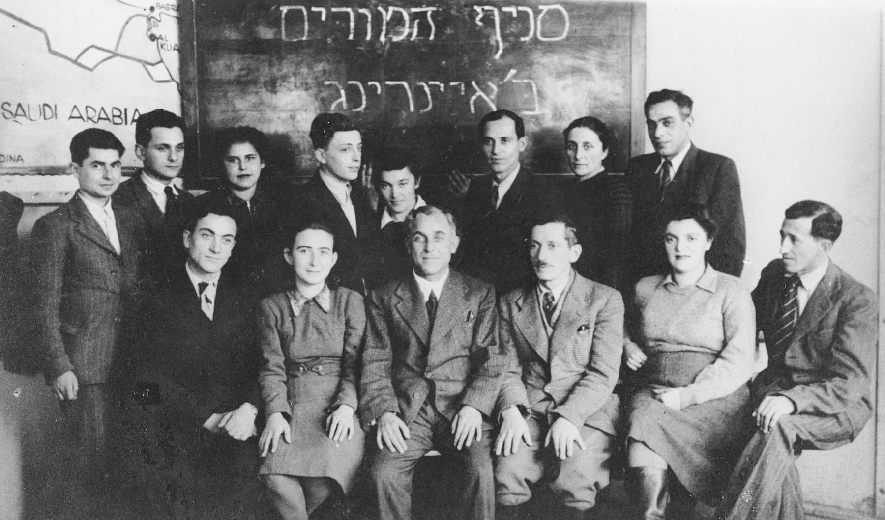 Group portrait of teachers in the Ainring displaced persons camp.
