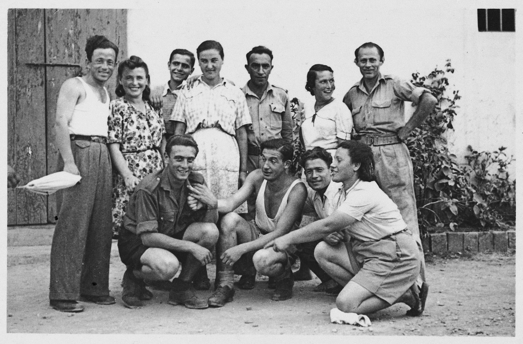 Group portrait of members of Kibbutz Maestro in Venice.  Boris Shub is pictured on the lower left.