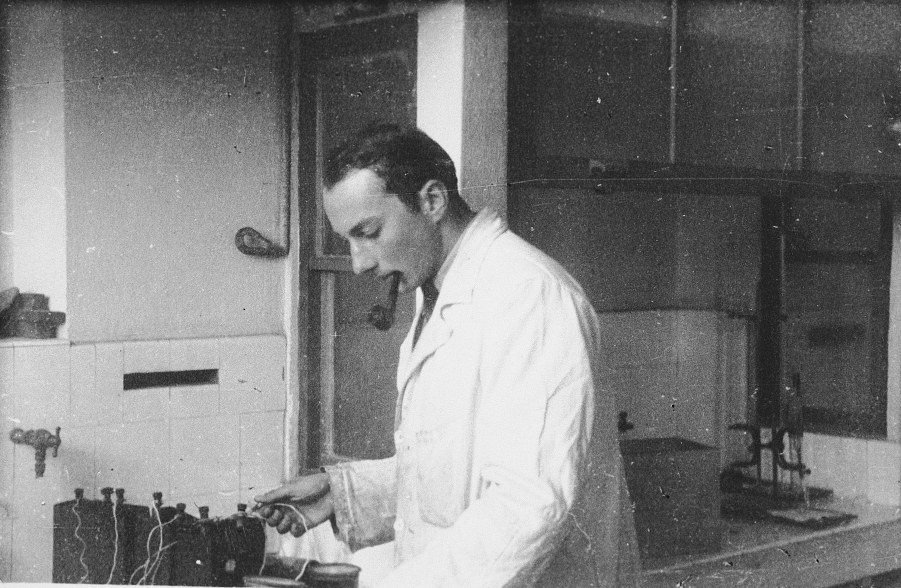 Otto Giniewski, a leader of the French Zionist underground, works in his chemistry laboratory at the University of Grenoble.