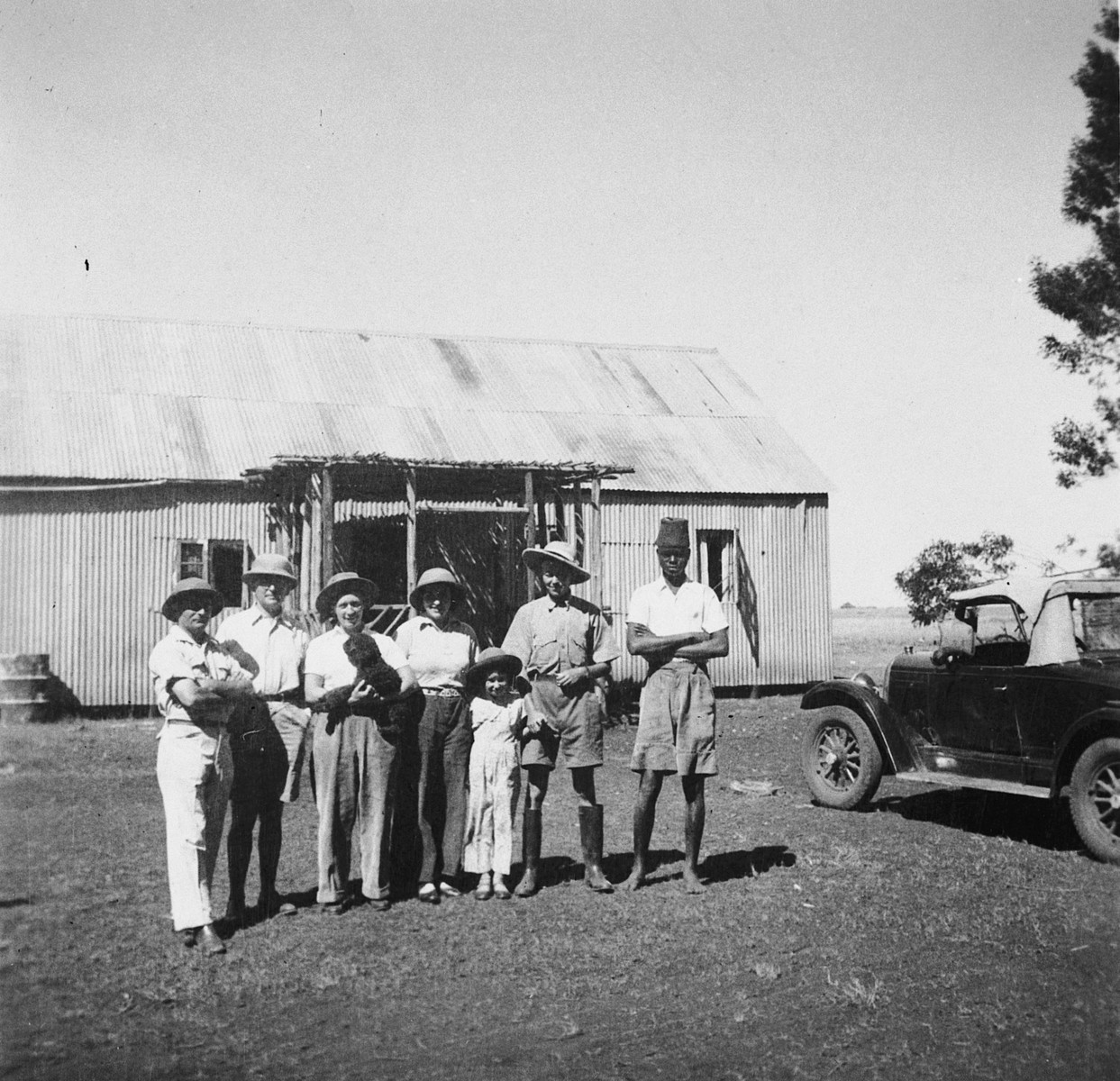 Members of a Jewish refugee family pose with an African assistant on their farm in Kenya.  Pictured are members of the Zweig family.  Stefanie Zweig is third from the right.