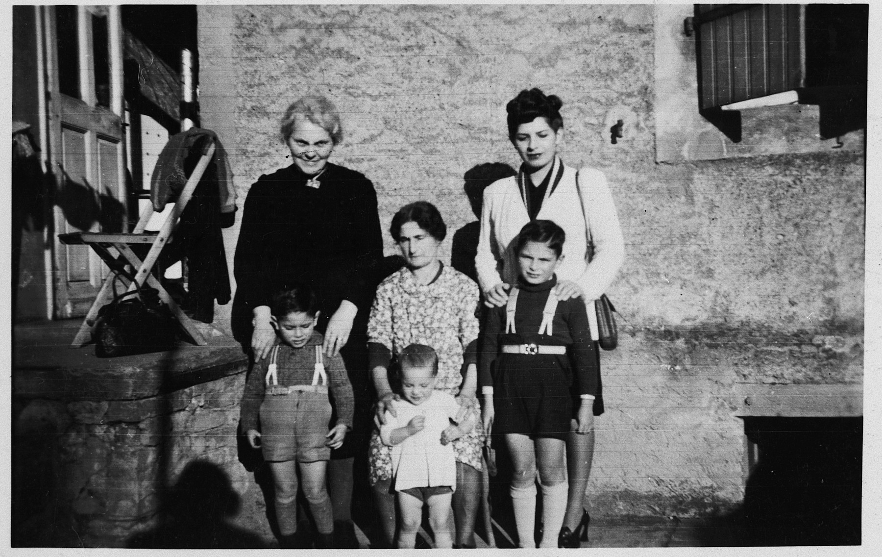 Portrait of the Marx family shortly after the war.  Pictured in the back are Grandmother Marx and Henny Marx.  In the front row are the brothers Claude, Robert and Gerard.