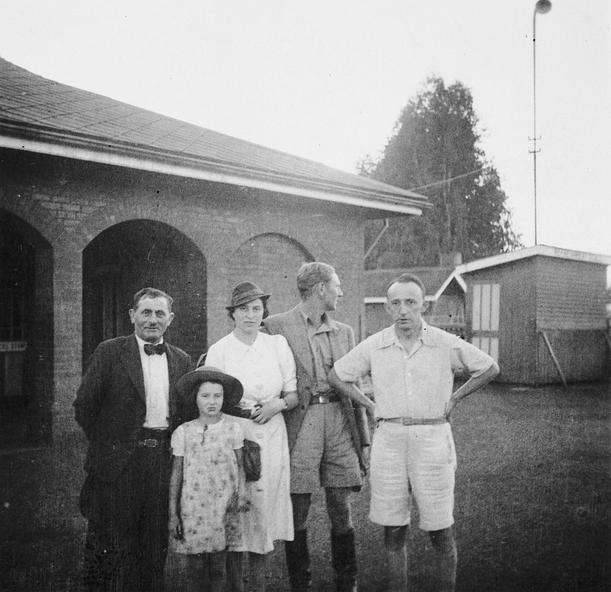Members of a Jewish refugee family pose with friends on their farm in Kenya.  Pictured are members of the Zweig family. The daughter, Stefanie Zweig, is in the front.