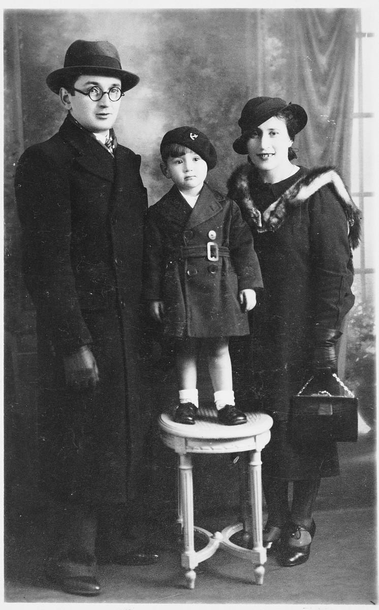 Prewar portrait of the Lichtenstein family.  Pictured are Menachem Mendel, Israel and Shifra Lichtenstein.