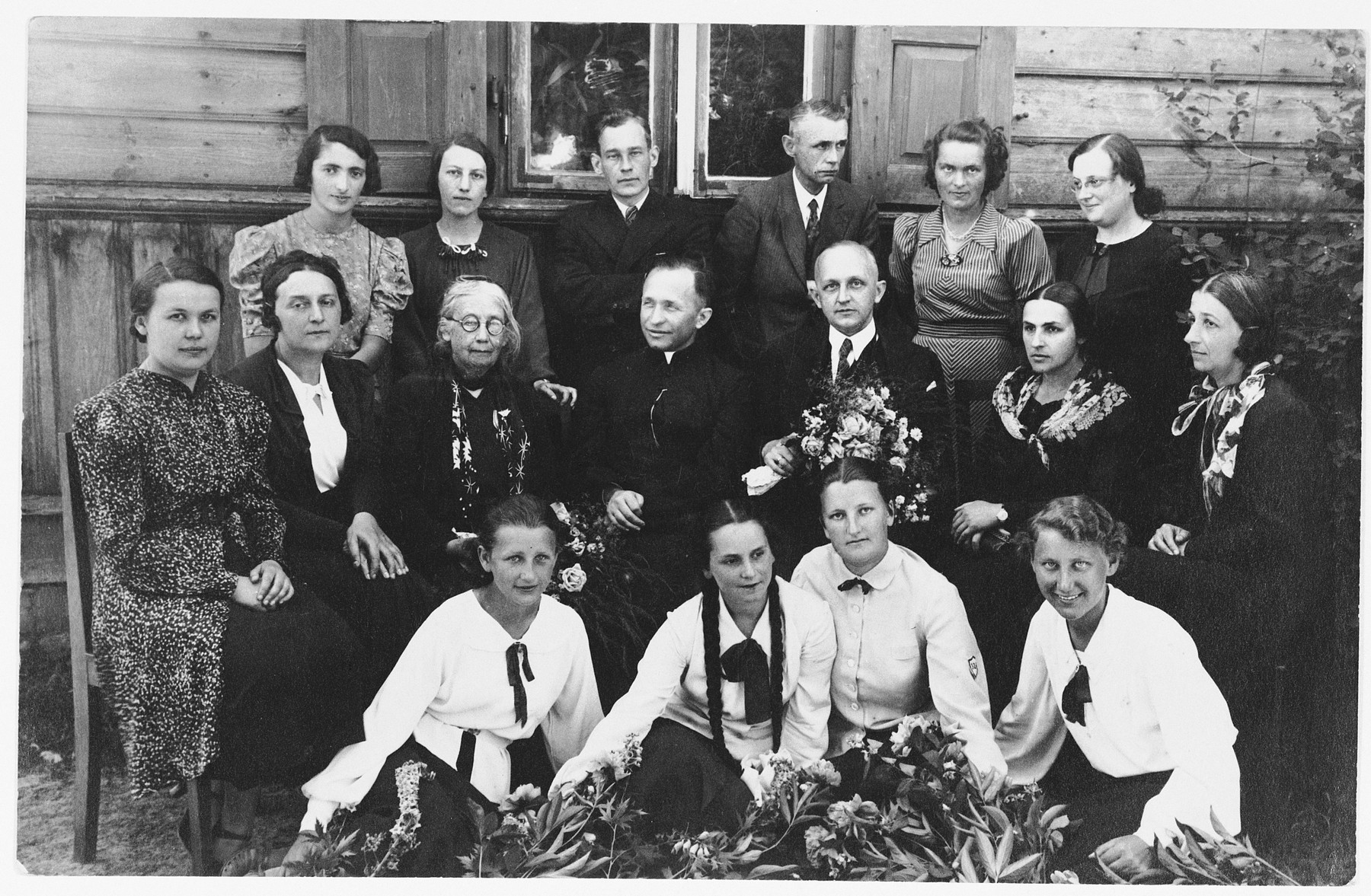 Group portrait of Polish and Jewish students and their teachers at a gymnasium in Lukow, Poland.  Among those pictured are: Jadwiga Dzido (front row on the right) and Zophia Szlendak (front row, second from the left).  During the German occupation both girls joined the resistance. Zophia was subsequently killed by the Gestapo.