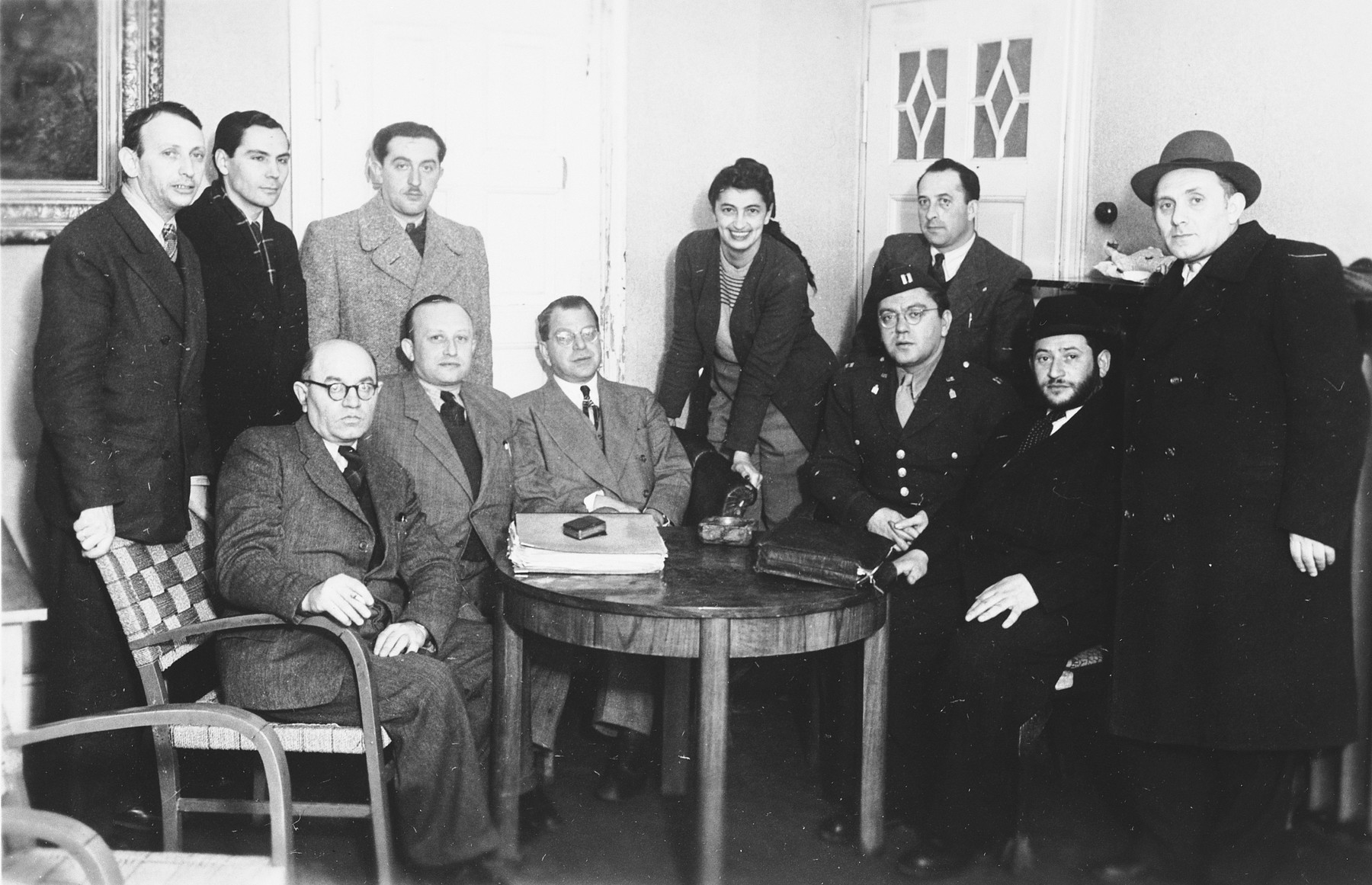 Group portrait of members of a Jewish committee in the Stuttgart displaced persons camp.