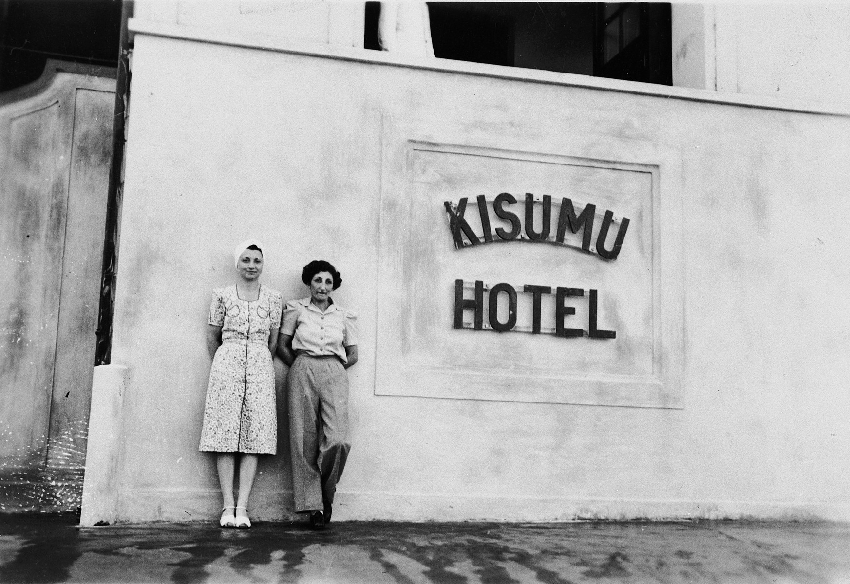 A Jewish refugee poses with a friend outside the Kisumu Hotel in Kisumu, Kenya.  Pictured is Ruth Weyl and a friend.