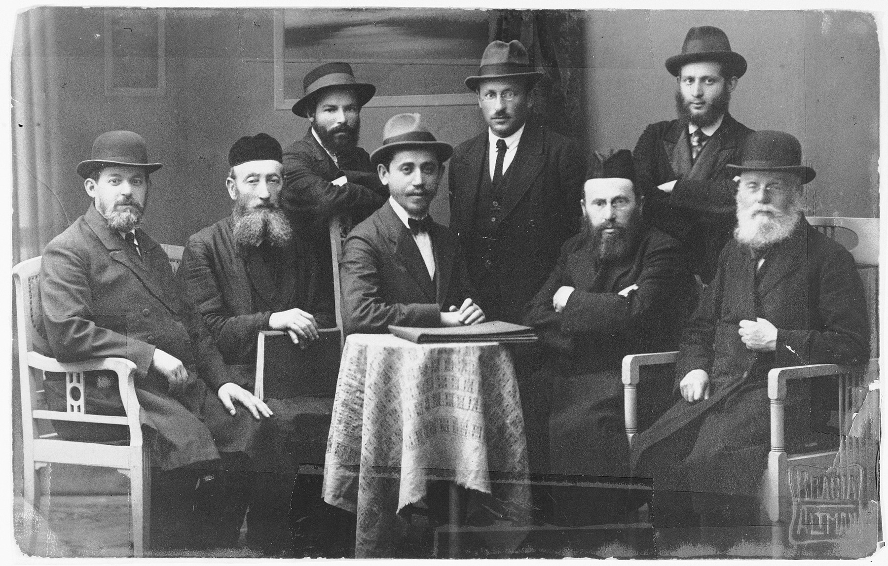 Group portrait of religious Jews in Sosnowiec.  Seated first from the right is Yosef Israel Wroncberg who was a rabbinics teacher.  The photo was taken in the studio Stanislas Altman, a Jewish photographer who perished in Auschwitz.