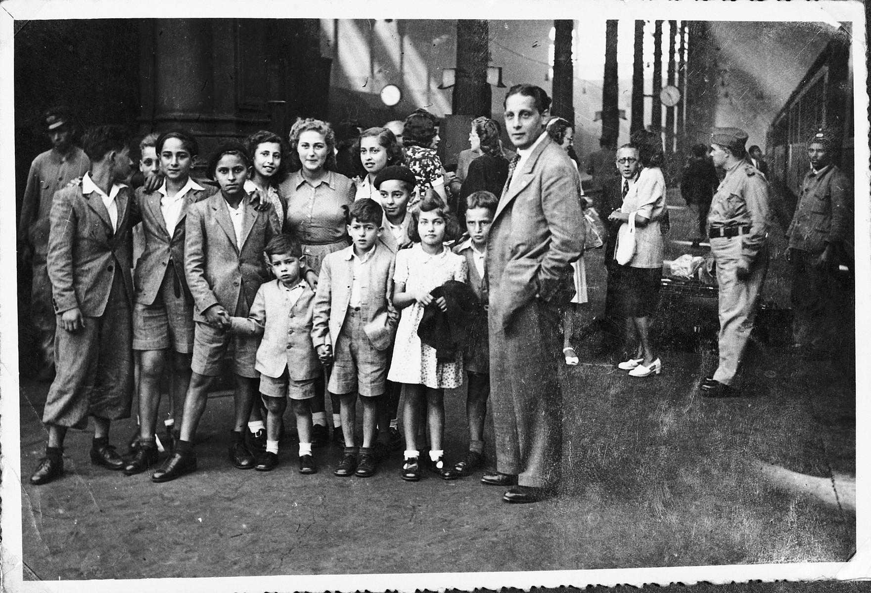 Jewish refugee children gather in a train station in Lisbon prior to their departure for Palestine.
